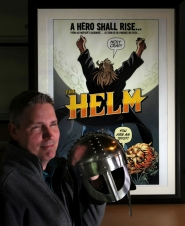 by: L.E. BASKOW What would you do if you had a magical helmet with super powers? Jim Hardison, author of the Helm comic, asks it for advice – and sometimes receives shocking answers.