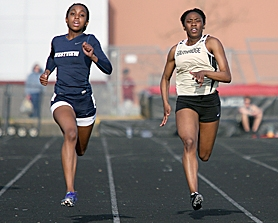by: Miles Vance FLYING — Westview junior Dominique Keel (left) and Southridge sophomore Sabrina Moore speed toward the finish line in the 200-meter dash at Southridge High School last week.