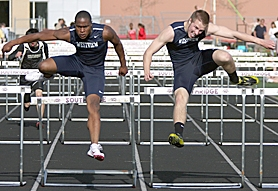 by: Miles Vance SEASON FINALE — Westview's Uche Uba (left) and Matt Landon clear the final hurdle last week at Southridge High School.