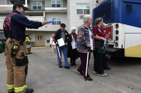 by: Jaime Valdez Tualatin Valley Fire & Rescue Firefighter Kevin Bebb directs 