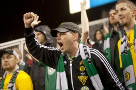by: PATRICK COTE Portland Timbers fans cheer their team to a 1-1 tie at Seattle.