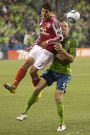 by: PATRICK COTE Sal Zizzo (left) of the Portland Timbers battles Tyson Wahl of the Seattle Sounders for the ball. The teams drew 1-1 Saturday night at Qwest Field.