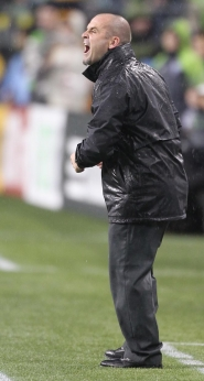 by: OTTO GRUELE JR. Portland Timbers coach John Spencer directs his team from a rainy spot on the sidelines during last Saturday's 1-1 tie in Seattle.