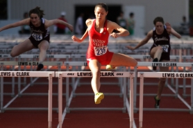 by: JAIME VALDEZ Monica Danciu of Madison High clears the last hurdle en route to winning the 100-meter event at the PIL 5A track and field meet.