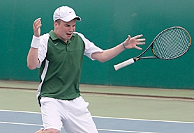 by: Miles Vance RELIEF — Jesuit senior Gram Leahy drops his racket and falls to his knees after scoring the last point to win the Metro League district singles title on Saturday at Tualatin Hills.