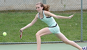 by: Miles Vance FAB FROSH — Jesuit freshman Erin Larner played a big role in the Crusaders' runner-up finish at district by winning the singles title at Tualatin Hills Tennis Center on Saturday.