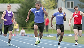 by: Miles Vance JUST FLAT FAST — Aloha's Thomas Tyner (here flanked by Sunset's Reggie Coulter, Aloha's Sheldon Prince and Lincoln's Austin Cheadle) races to victory in the 100 meters on Friday at the Metro District Track meet.