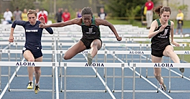 by: Miles Vance DISTRICT STARS — Jesuit's Garmai Gorlorwulu (center) and teammate Mackenzie Mathews race to a 1-2 finish in the 100-meter high hurdles at Friday's Metro League district meet at Aloha High School.