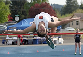 by: Miles Vance FLYING — Beaverton's Morgan Rennekamp soars to victory in the high jump at the Metro district track meet on Friday at Aloha High School.