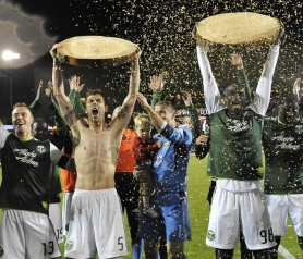 by: STEVE DYKES Happy Portland Timbers after a 1-0 victory over Columbus include (from left) Jack Jewsbury, shirtless Eric Brunner, goalkeeper Troy Perkins and Mamadou