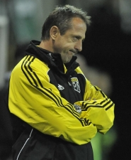 by: STEVE DYKES Columbus Crew coach Robert Warzycha follows the second-half play as his team falls 1-0 to the Portland Timbers at Jeld-Wen Field.