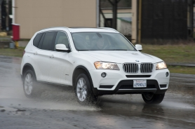 by: NORTHWEST AUTOMOTIVE PRESS ASSOCIATION The 2011 BMW xDrive 28i is at home in rainy Pacific Northwest weather.