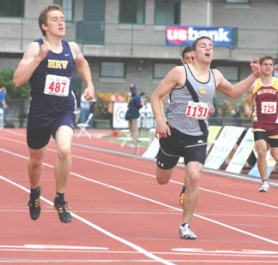 by: John Brewington GREAT EFFORT—St. Helens' Will Lawrence (right) broke a school record in the 400 but came up just a hair's breadth short of winning a state championship in the 5A meet on Saturday.