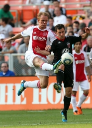 by: NED DISHMAN Siem De Jong (left) of AFC Ajax controls the ball against Stephen King of D.C. United at RFK Stadium in an exhibition game on Sunday.