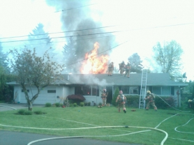 by: courtesy of CFD No. 1 Flames engulf a home at 143 Valley View Drive in Oregon City.