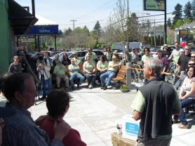 by: Submitted Photo Hillsdale resident and neighborhood advocate Richard Stein addresses community members gathered to dedicate the plaza that's now complete between Baker & Spice and Food Front Cooperative Grocery in the Hillsdale Shopping Center.