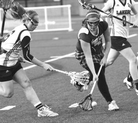 by: VERN UYETAKE Claire Offer looks to corral a ground ball in West Linn's semifinal loss to Lake Oswego. The Lions picked up two road wins to reach the semis.