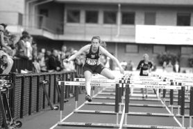 by: MATTHEW SHERMAN Casey Livesay clears the last hurdle in the finals 100-meter hurdles at last week's state track meet in Eugene. Livesay finished seventh in the event and ran on the 4x100 relay team.