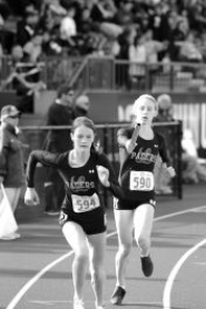 by: MATTHEW SHERMAN Madi Greenleaf hands the baton to Kelly O'Neill in the final of the 4x400 relay in Eugene last week