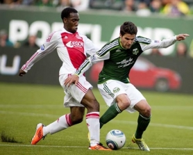 by: CHRISTOPHER ONSTOTT Vurnon Anita (left) of AFC Ajax sweeps in to take the ball from the Portland Timbers' Sal Zizzo.