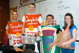 by: Cathy Siegner Tualatin High School juniors Matt Miller, Jacob Gifford, Leticia Tafolla and Juliana Porter were busy on Friday collecting donations for the school's annual food drive.