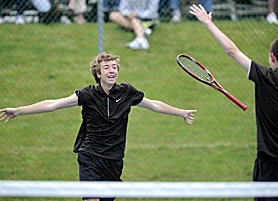 by: John Lariviere FINALLY — Jesuit's Nick Biggi lets his racket fly and races to hug partner Connor Leahy after the Crusader duo beat teammates Nic Mulflur and Sam Stephenson to win the Class 6A state title on Saturday.