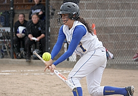 by: Miles Vance LAY IT DOWN — Aloha's Alex Portesi bunts early in her team's 2-0 win over South Medford in the Class 6A state playoffs on Monday at Aloha High School.