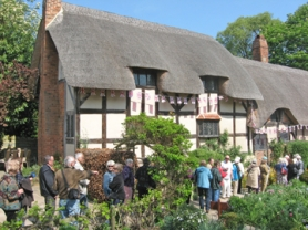 by: Barbara Sherman AWAY FROM LONDON — Members of the tour group wait in line with other tourists to enter the thatched-roofed Anne Hathaway's Cottage in Stratford-upon-Avon, which is two hours outside London.