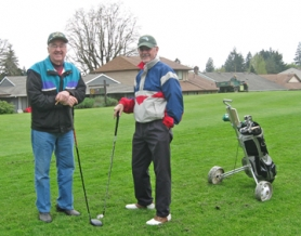 by: Barbara Sherman NOT QUITE SUMMER — Enjoying a cool spring day on the Summerfield Golf Club links on a recent men's play day are Cecil Sims (left) and Gerry Craig,