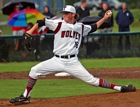 by: DAN BROOD AUSTIN POWERS – Tualatin High School senior Austin Richmond gets ready to fire a pitch to the plate during Monday's state playoff game. Richmond struck out nine batters in six innings of work.