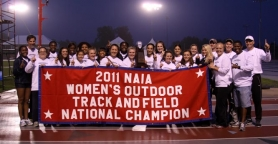 by: COURTESY OF CONCORDIA UNIVERSITY The Concordia Cavaliers celebrate their NAIA women's track and field title Saturday at Marion, Ind.