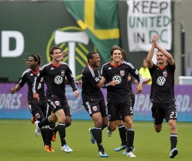 by: STEVE DYKES Perry Kitchen (right) of D.C. United celebrates with teammates after scoring in the first half of a 3-2 win over the Portland Timbers.