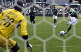 by: STEVE DYKES Kenny Cooper attempts a penalty kick as the Portland Timbers fall to D.C. United 3-2 Sunday at Jeld-Wen Field.