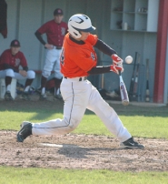 by: John Brewington FOUL BALL—Scappoose's Nathan Kranyak fouls off a ball during last Wednesday's game at Douglas.