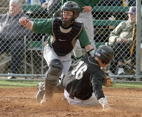 by: MILES VANCE Left, West Linn catcher DJ Clark makes a play at home plate during last week's second-round playoff game against Jesuit. Clark had an inside the park home run in the game for the Lions. Below, Clayton Gelfand gets set to field a throw to second base in last week's playoff loss to the Crusaders.
