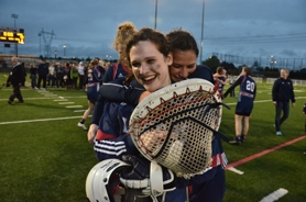 by: VERN UYETAKE Lake Oswego goalie Carly Hall gets a hug following her team's win over Oregon City. Hall had 16 saves in the title game and was named MVP of the playoffs.