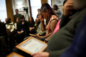 by: CHRISTOPHER ONSTOTT A tearful Darlean Armstead clutches her certificate after graduating from the Portland Police Bureau's Service Coordination Team rehabilitation program for the city's most frequently arrested citizens.