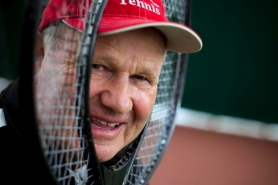by: Christopher Onstott Gundars Tilmanis, 67, says stepping down as tennis coach at Lewis & Clark College after two years will only free up time for him to do other things.