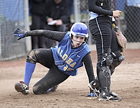 by: Tom Patterson SHE'S SAFE — Aloha's Ryan Patterson slides in home to score and tie Tuesday's Class 6A state semifinal against South Salem at 2-2.