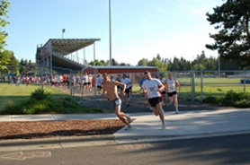 by: Submitted photo RUNNING STRONG -- Runners come out of Sherwood High School during the annual Run for the Roses races set for Saturday.