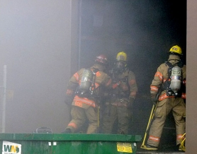 by: Dick Harris Portland firefighters used respirators to check inside a Northeast Columbia Boulevard warehouse Thursday evening as thick smoke from a small fire filled the building. No one was injured in the incident.