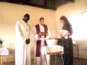 by: Contributed photo The Rev. Mark Rabe, center, performs a baptism in Kenya, where he works as a missionary. The pastor will speak at Redeemer Lutheran Church in Gresham on June 10-11.