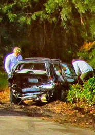 by: Eric Norberg The car driven by Paul Bruner of Steilacoom, Washington, skidded after the impact into the bushes on the west side of McLoughlin Boulevard. Although other motorists stopped to help, Bruner was reported uninjured, although his passenger was taken to Providence Milwaukie Hospital as a precaution.
