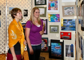 by: David F. Ashton While in the photographic exhibition, Roslyn Huard and Sarah Middleton say they traveled from Beaverton to attend the 2011 Multnomah County Fair.