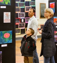 by: David F. Ashton Tobias Schenk admires art with his parents, Ryan and Brandy Schenk.