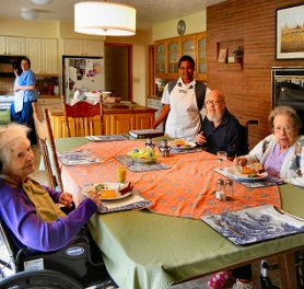 "by: Elizabeth Ussher Groff Three of the five current residents at ""Martha & Mary Home""begin their lunch in the large kitchen where, for 54 years, Bob and Evelyn Dieringer and their family ate meals – until the house was donated and renovated as an adult care home for end-of-life care."