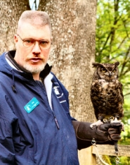 by: David F. Ashton Phil Hubert, an education bird handler with the Audubon Society of Portland, introduces folks to Julia, a great horned owl.