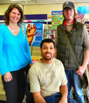 "by: Elizabeth Ussher Groff Kerry Pinney and Daniel VanderMolen (standing) introduce Jace Sakamoto (in the wheelchair) to Jill's Hallmark Shop, a featured business of the United Cerebral Palsy's program ""Neighborhood Waves"" in the Woodstock neighborhood."