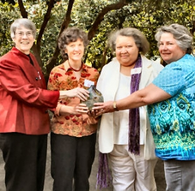 "by: David F. Ashton Human Solutions' executive director, Jean DeMaster, presents their second annual ""Jane Addams Social Activist Award"" to Chiquita Rollins, along with board member Sheila Holden, Pacific Power Regional Community Manager and the organization's board president, Carla Piluso, retired Gresham Chief of Police."
