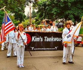 by:  Sellwood Taekwon-Do students, as they marched in a previous Junior Rose Parade.